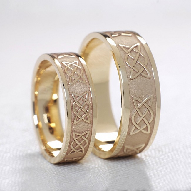 Gold or Platinum wedding bands with celtic knot laser design v1201